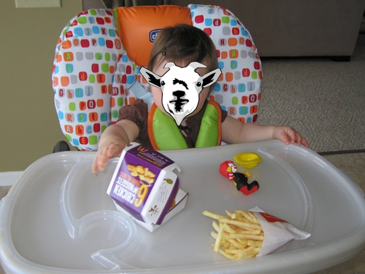 Baby's first Happy Meal (baby face hidden to protect privacy)
