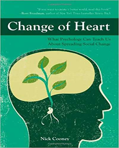 Cover for the book, The Change of Heart. Features a green background with a large silhouette of a human head takes up the most space. Inside the head is a yellow area where a green plant is growing.