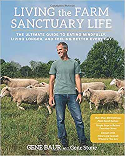 Cover for the book Living the Farm Sanctuary Life. Features a picture of a man standing in a field with a group of sheep.