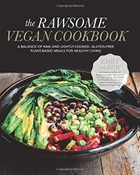 Cover for the book The Rawsome Vegan Cookbook. Features a colorful array of vegetables in a black bowl sitting on top of a wooden table with a black background.