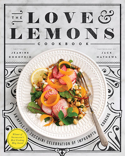 Cover for the book, The Love and Lemons Cookbook. Features a plate of colorful plant-based food on top of a grey background.