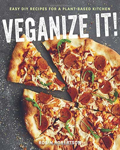 Cover for the book, Veganize It. Features a delicious-looking pizza sitting on a grey countertop.