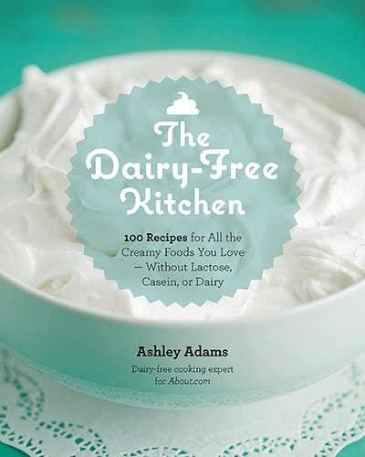 Cover for the book, The Dairy-Free Kitchen. Features a close up of a bowl of whipped topping with a teal background.