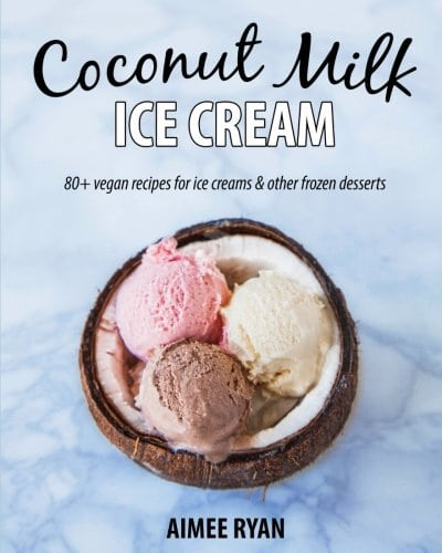 Cover for the book, Coconut Milk Ice Cream. Features a ice cream - 3 scoops, 1 chocolate, 1 vanilla, and 1 strawberry - inside a half coconut shell sitting on top of a blue background.