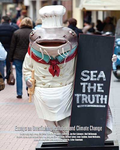 Cover for the film, Sea the Truth. Features a large fish holding a black chalkboard sign on a busy sidewalk.
