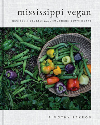 Cover for the book, Mississippi Vegan, that features a bowl of fresh food also surrounded by colorful fresh foods.
