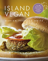 Cover for the book, Island Vegan. Features a close up of a veggie burger on a bun with lettuce.