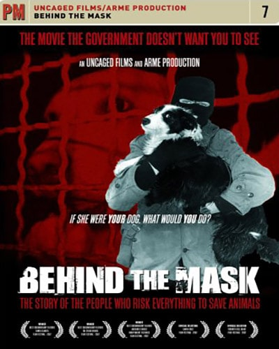 Cover for the film, Behind the Mask. Features a red background with a image of a person in a mask carrying a dog to safety.