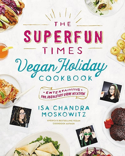 Cover for the book, The Superfun Times Vegan Holiday Cookbook, featuring a variety of foods sitting on a white background.