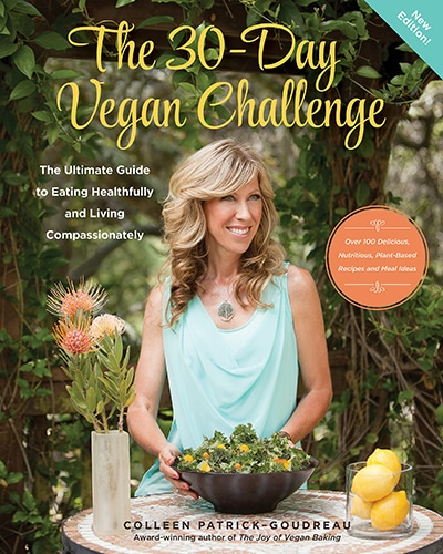 Cover for the book, The 30 Day Vegan Challenge, features a picture of the author standing at a table with a salad in front of her.