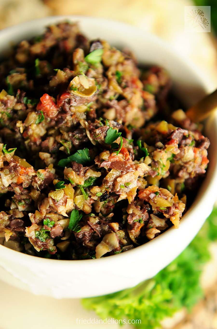 Closeup of a bowl of olive tapenade.