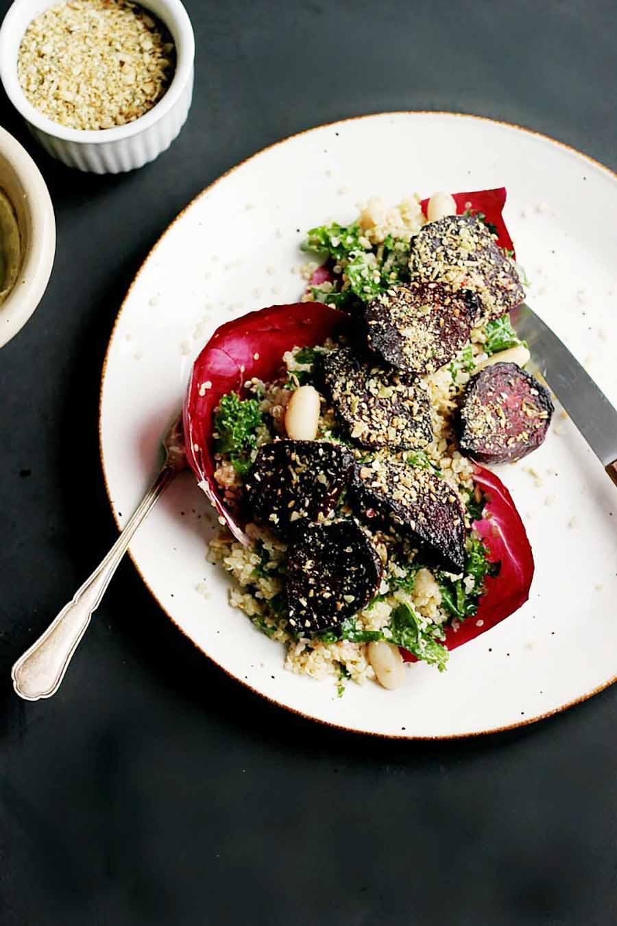 Roasted beet salad served inside a red cabbage leaf.
