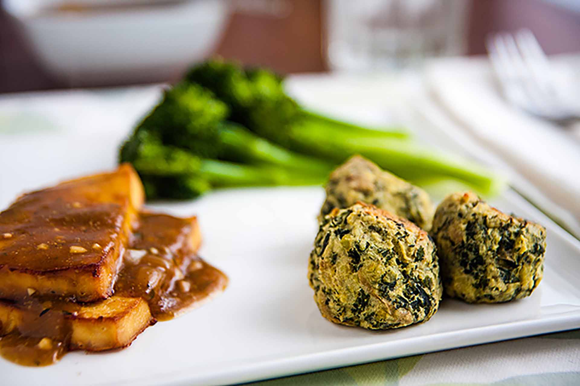Plate of food featuring colcannon puffs