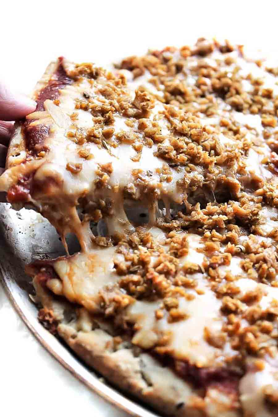 Sausage crumbles on a pizza